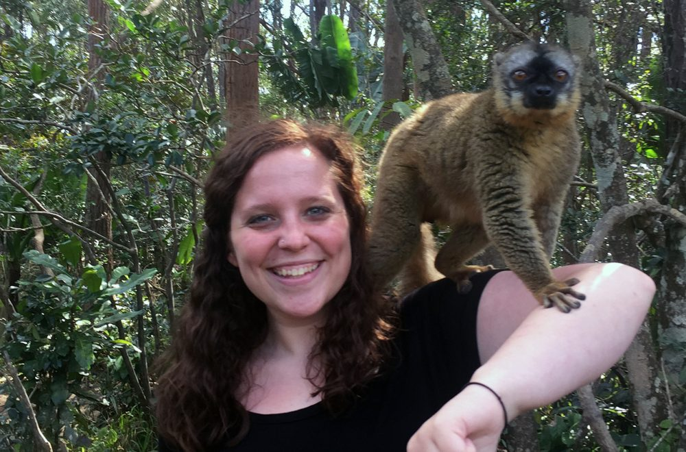Casey Stallman study aboard with a lemur in Madagascar